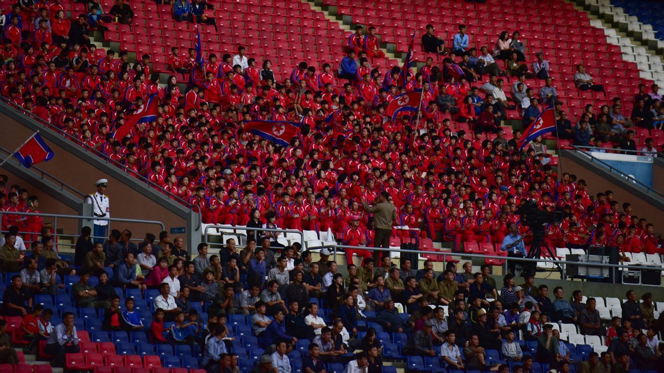 A group of close to 200 children, all dressed in red, were clapping and singing to the signals of an overenthusiastic chant conductor throughout the game