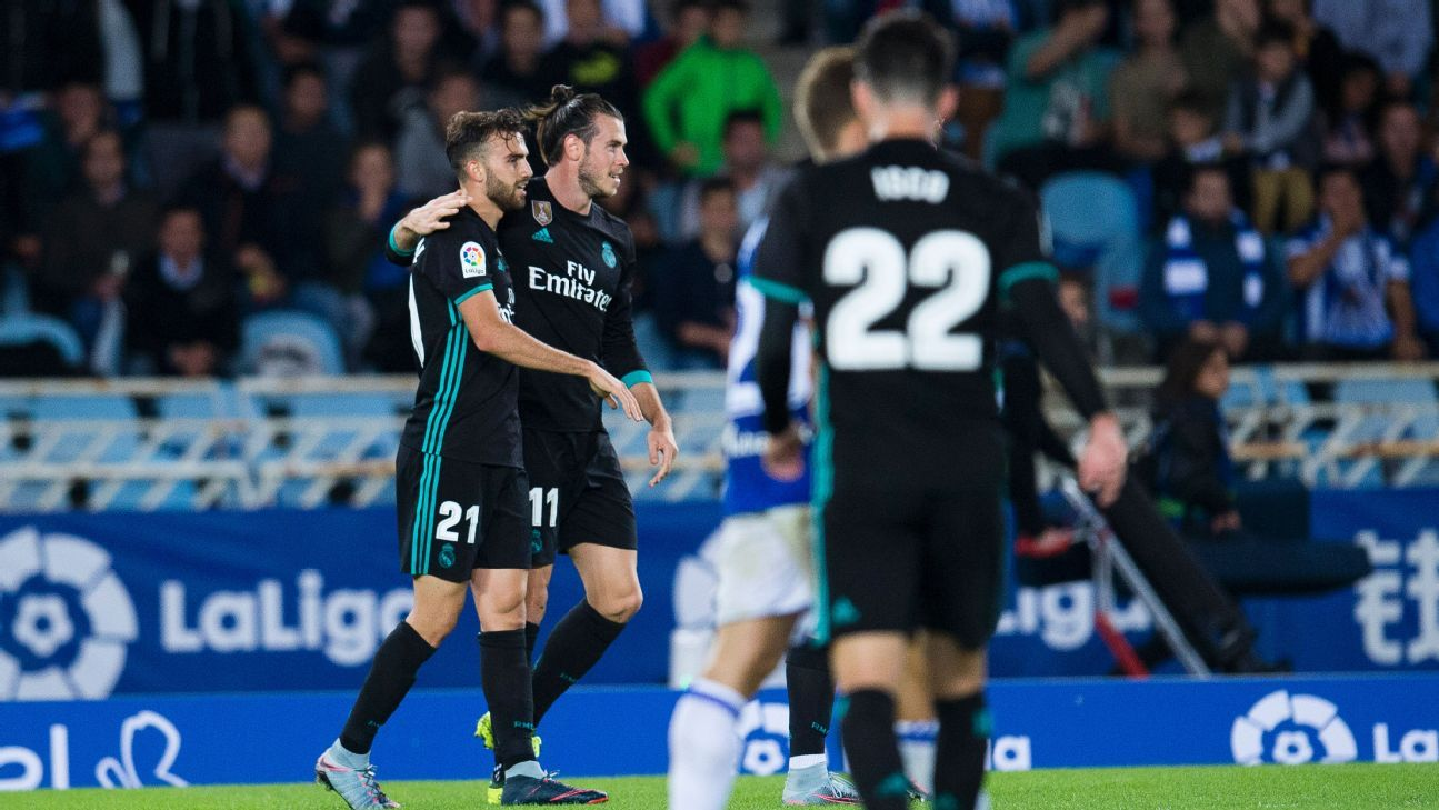 Gareth Bale and Borja Mayoral celebrate after the former scored his team's third goal in a win against Real Sociedad.