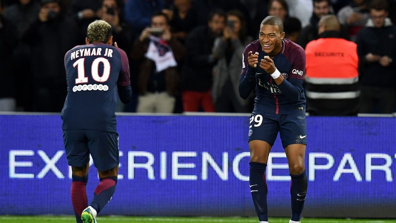 Neymar, left, and Kylian Mbappe celebrate during PSG's 2-0 win against Lyon in Ligue 1.