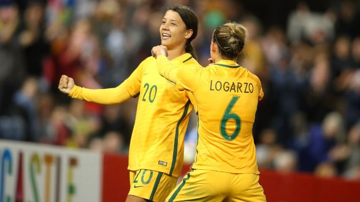 Sam Kerr celebrates one of her goals with Chloe Logarzo.