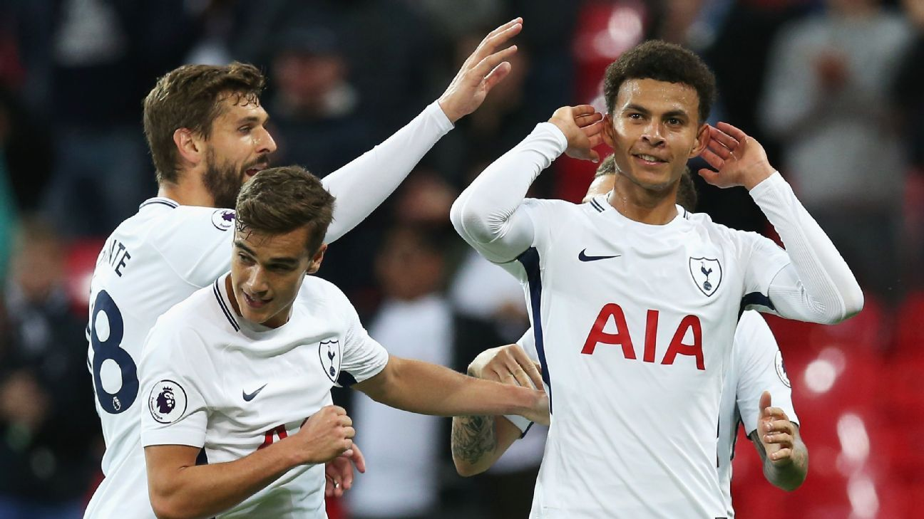 Dele AllI celebrates after scoring a goal for Tottenham in their Carabao Cup win against Barnsley.