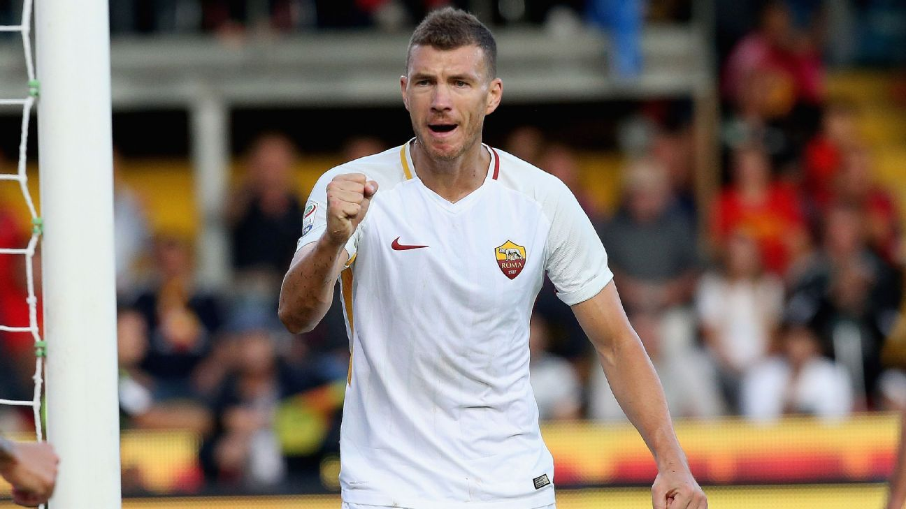 Edin Dzeko celebrates one of his goals against Benevento.