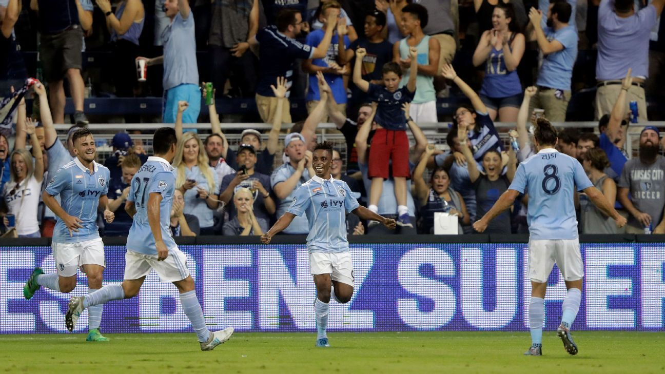 Latif Blessing and his Sporting KC teammates celebrate after opening the scoring against NY Red Bulls.