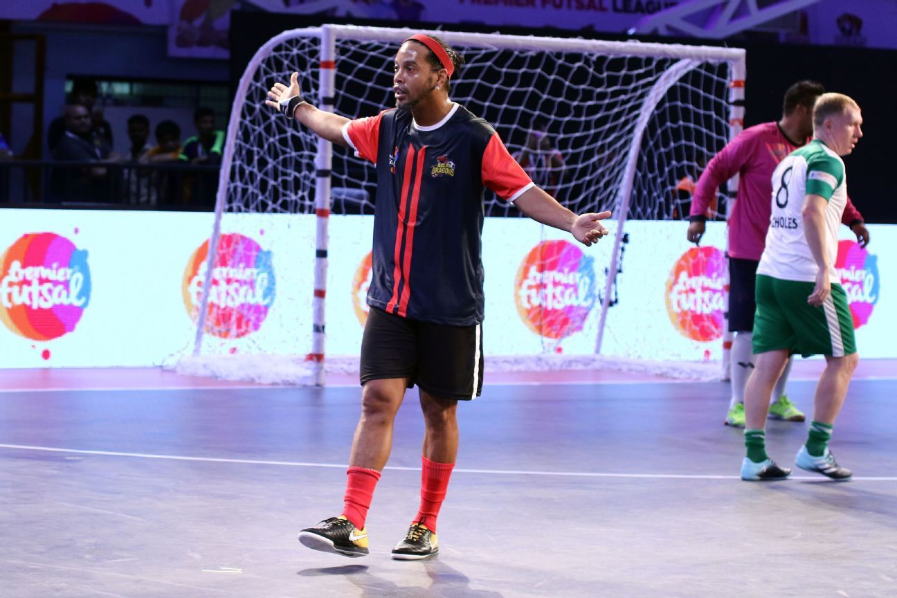 Ronaldinho and Paul Scholes during a Premier Futsal game between Delhi Dragons and Bengaluru Royals, in Bengaluru on Wednesday.