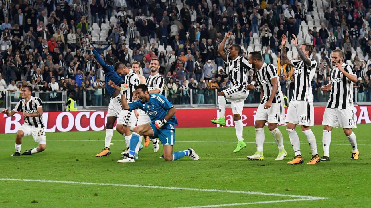 Juventus players celebrate after beating Torino in the city's Serie A derby.