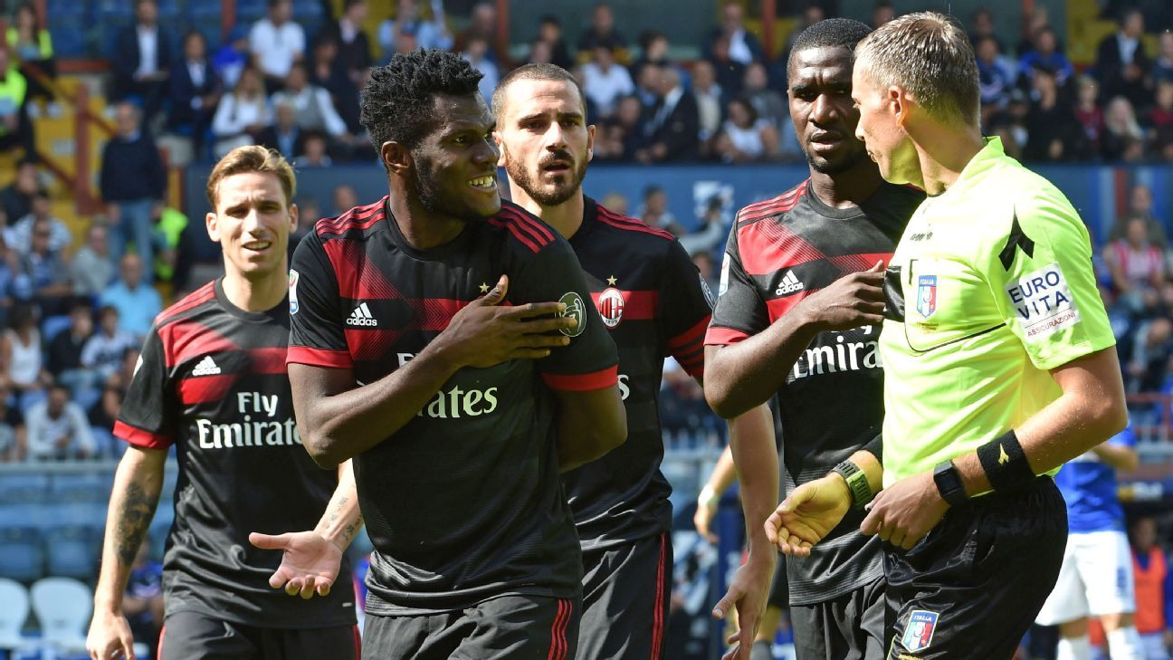 Milan players protest with the referee
