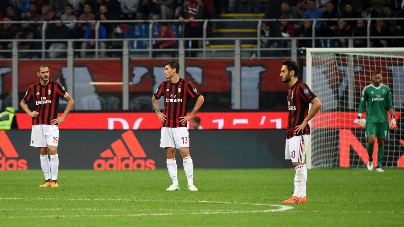Lucas Biglia, Leonardo Bonucci and Alessio Romagnoli react after conceding a goal in AC Milan's loss to Roma.