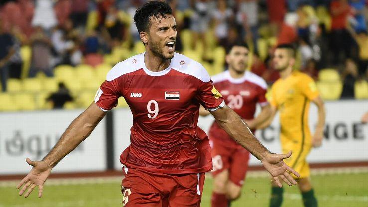 Omar Al Soma celebrates after scoring the equaliser for Syria against Australia.