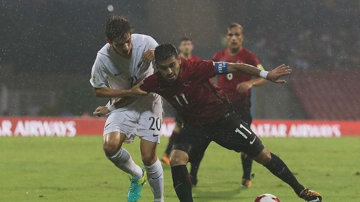Emlyn Wellsmore of New Zealand and Recep Gul of Turkey fight for the ball during their Group B encounter.
