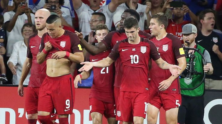 U.S. players celebrate after a goal against Panama with Pulisic