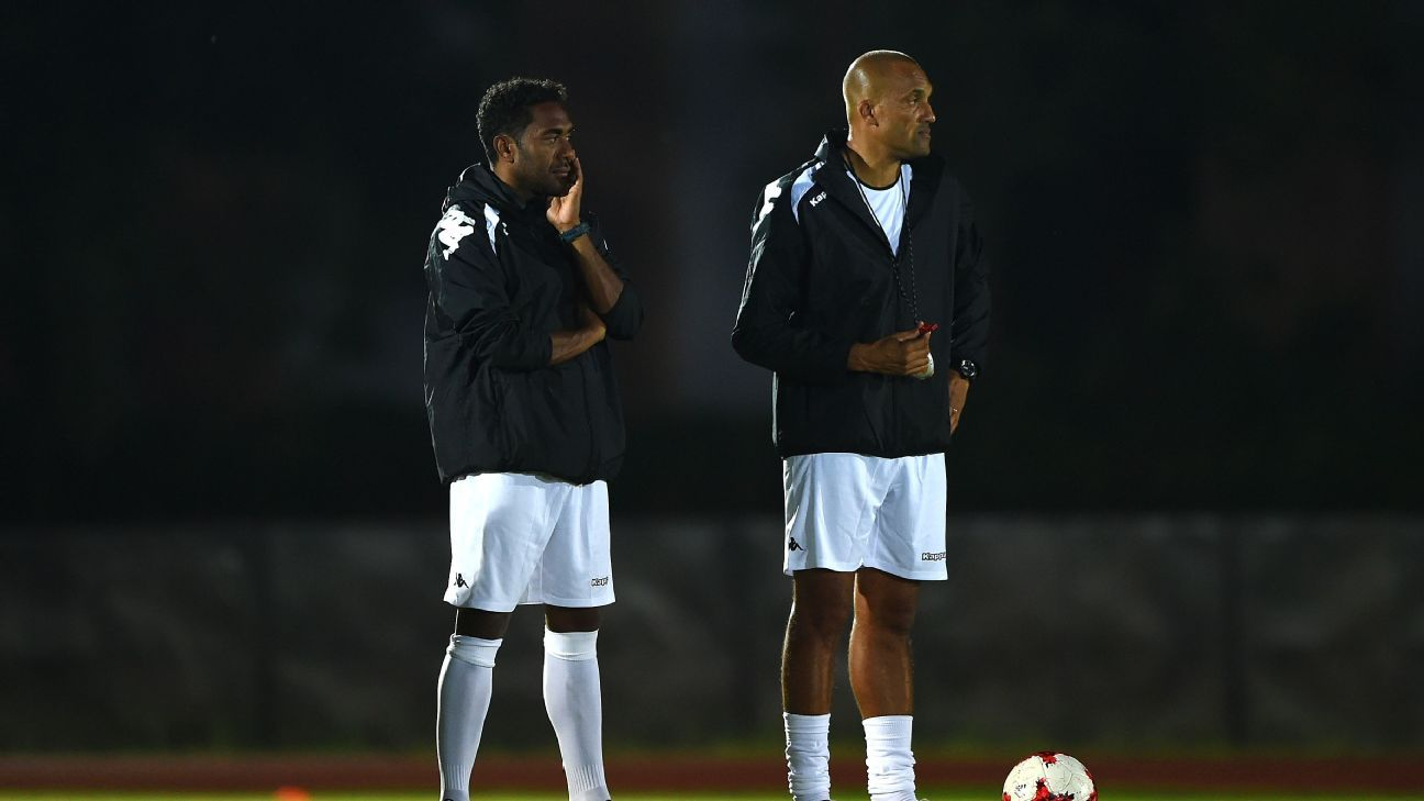 Dominique Wacalie (L) looks on during a training session ahead of New Caledonia's opening match against France.