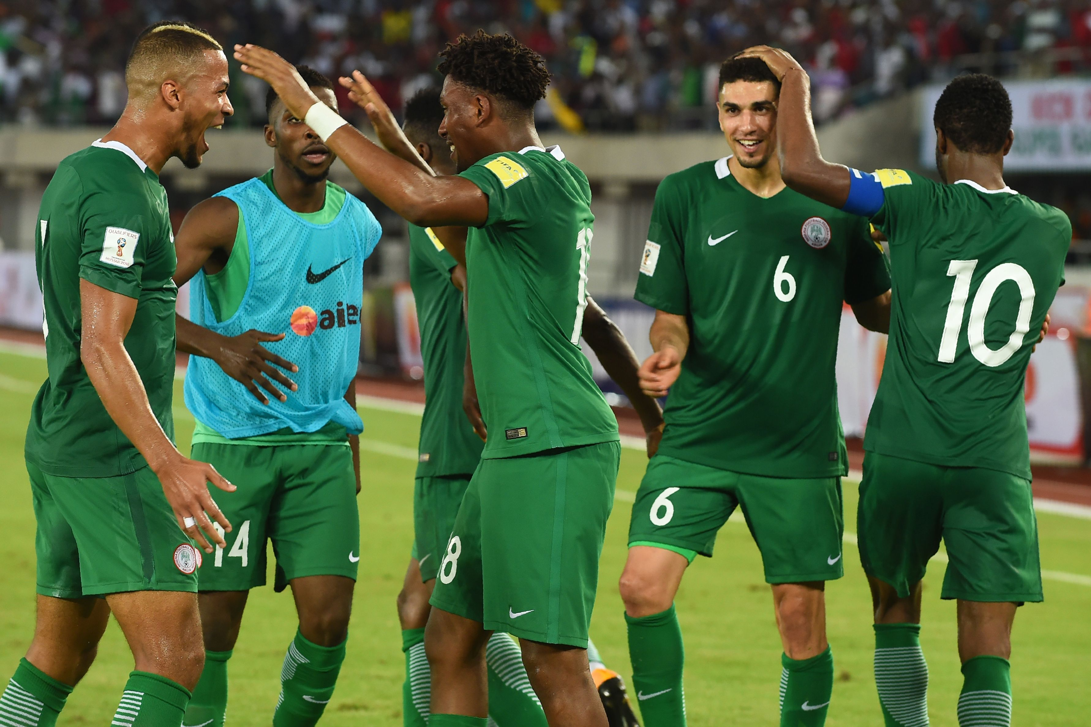 Nigeria's Alex Iwobi (c) celebrates with teammates