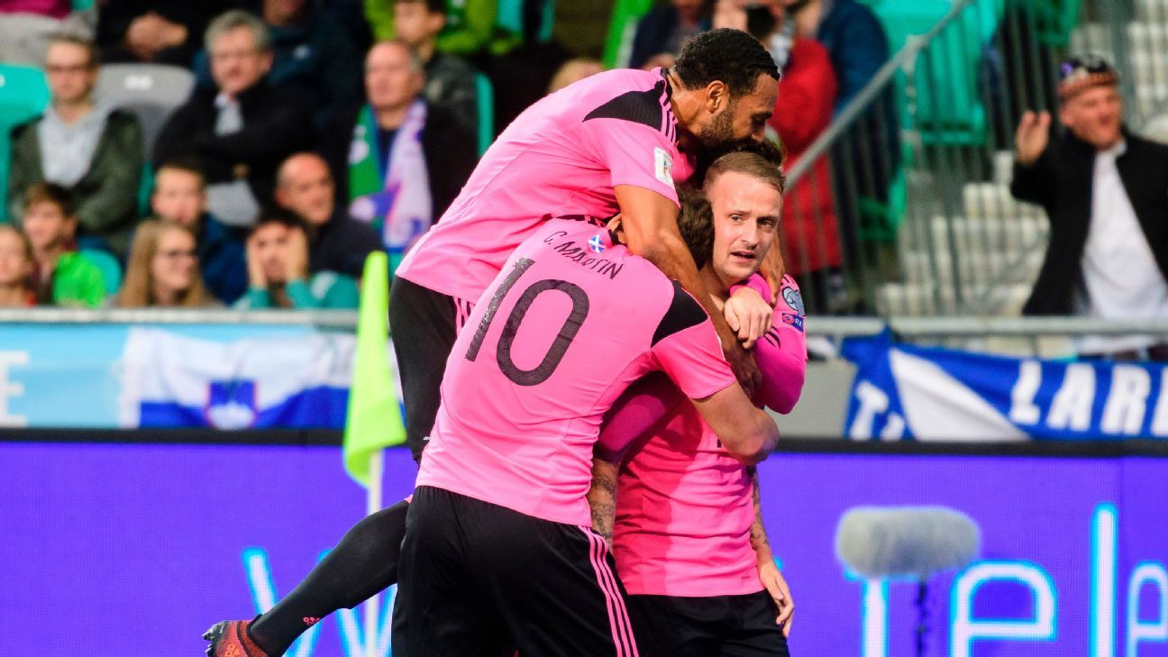 Leigh Griffiths celebrates scoring the opening goal for Scotland in Slovenia.