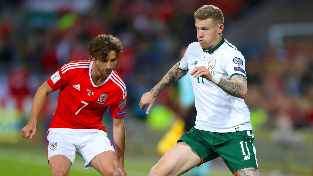 Wales' Joe Allen, left, and Republic of Ireland's James McClean battle for the ball.