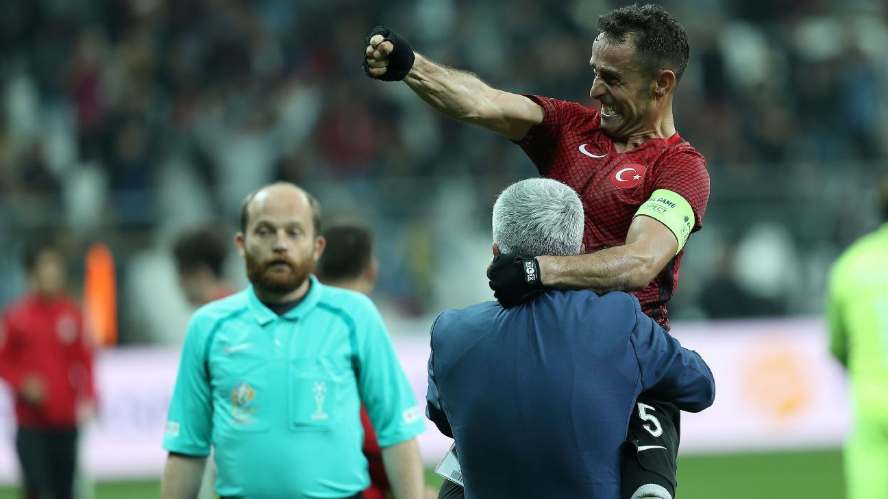 Turkey captain Osman Cakmak celebrates after his team's last-gasp winner