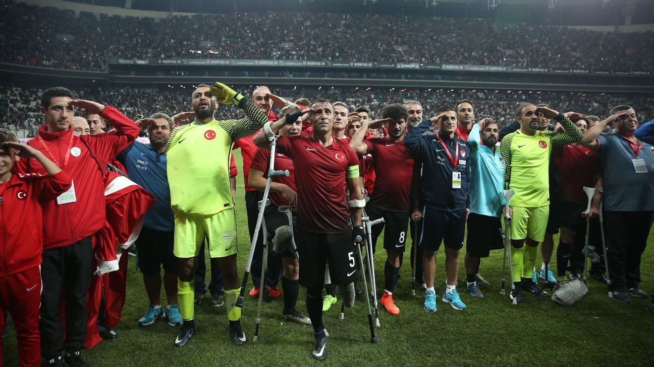 Turkey players salute as they celebrate victory in the final