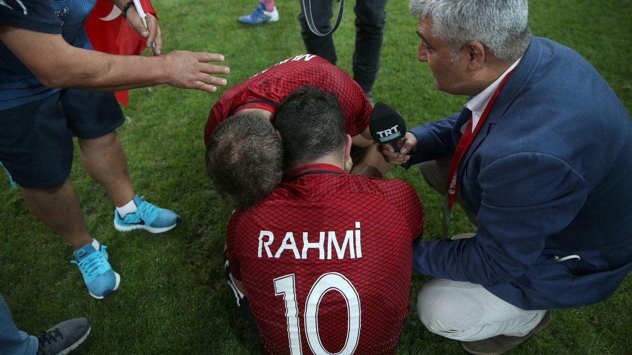 Rahmi and Osman Cakmak of Turkey embrace after winning the trophy in front of their home fans