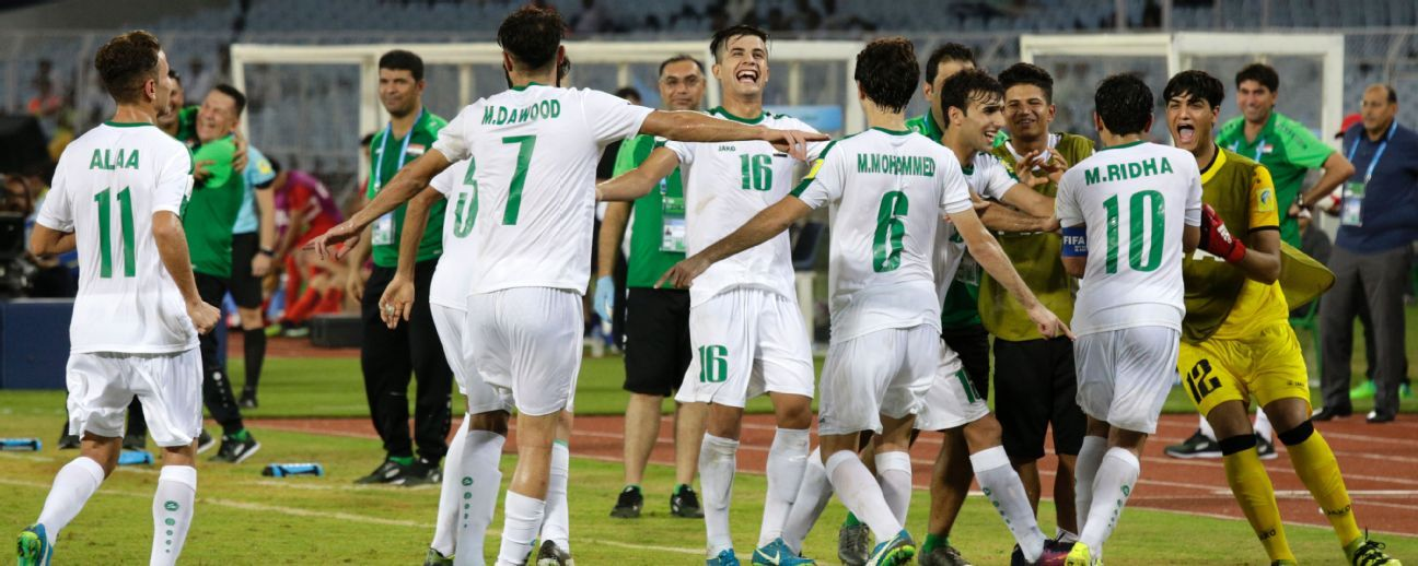 Iraq's players celebrate their win over Chile in Kolkata on Wednesday.