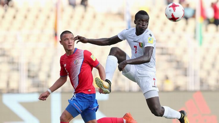 Fandje Toure, right, in action against Walter Cortes of Costa Rica. Toure scored against Iran as well as Costa Rica.