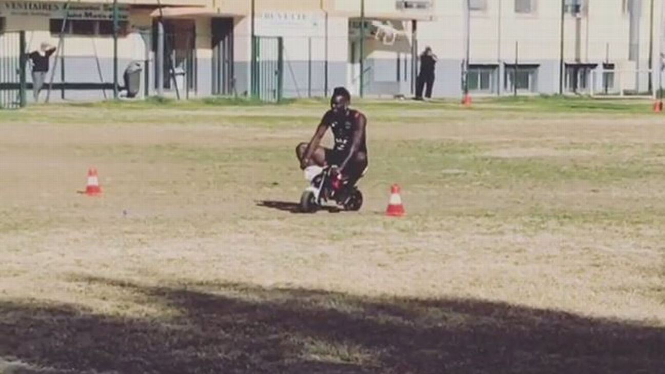 Mario Balotelli races around Nice's training ground on a mini-motorbike