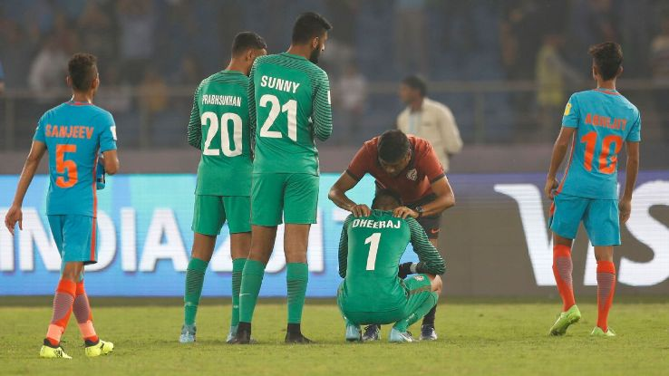 Dheeraj Singh (No. 1) is consoled after the loss to Ghana.