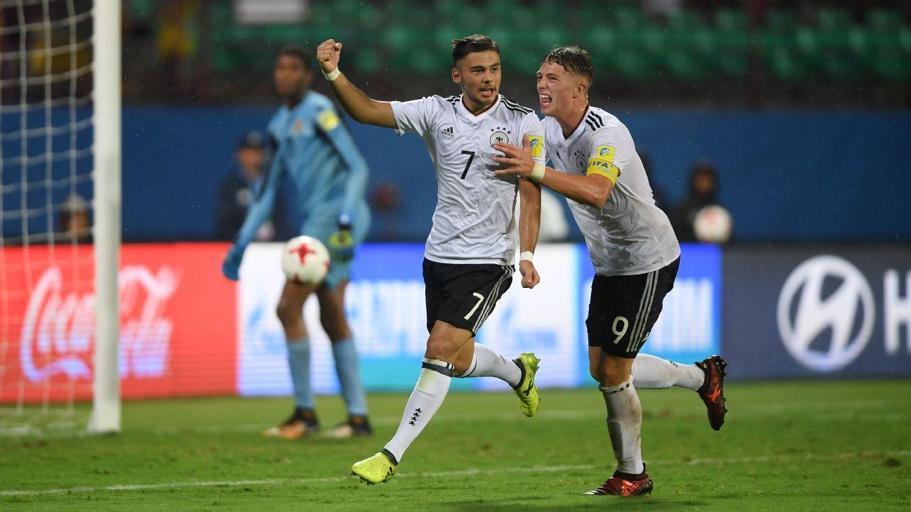 Sahverdi Cetin and Jann-Fiete Arp celebrate Germany's third goal.