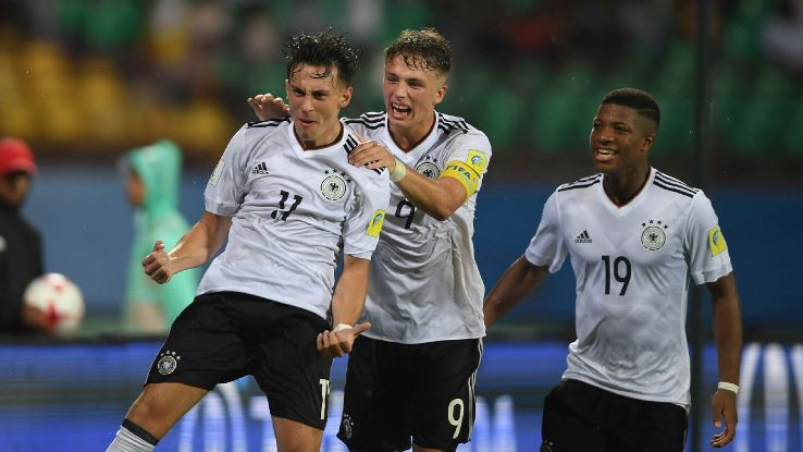 Germany's Nicolas Gerrit Kühn celebrates his goal with teammates Jann-Fiete Arp and Josha Vagnoman.