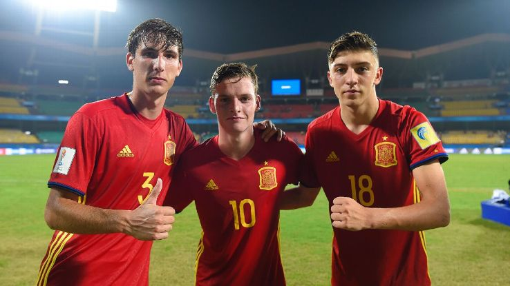 Spain's Juan Miranda, Sergio Gomez and Cesar Gelabert celebrate after the win over North Korea.