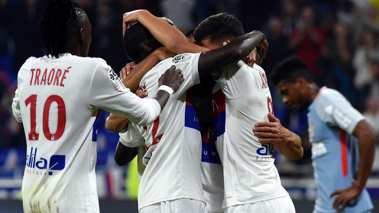 Lyon players celebrate after a Nabil Fekir goal in a 3-2 win against Monaco.