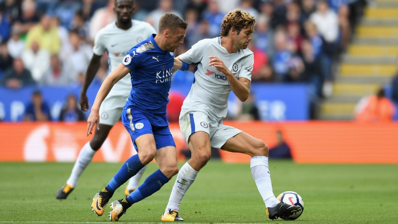 Leicester's Jamie Vardy and Chelsea's Marcos Alonso battle for the ball