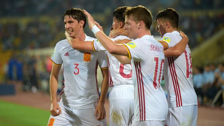 Juan Miranda celebrates after scoring Spain's first goal.