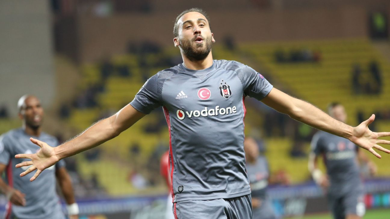 Cenk Tosun celebrates after scoring one of his two goals for Besiktas against Monaco.