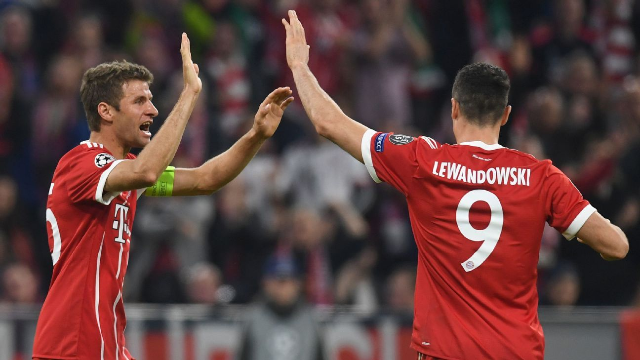 Thomas Muller, left, and Robert Lewandowski celebrate after Bayern Munich's opening goal against Celtic.