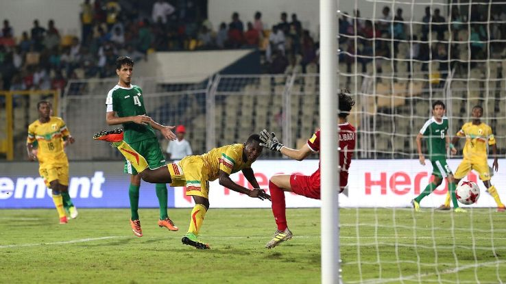 Lassana Ndiaye scores Mali's second goal during the match against Iraq in Goa.