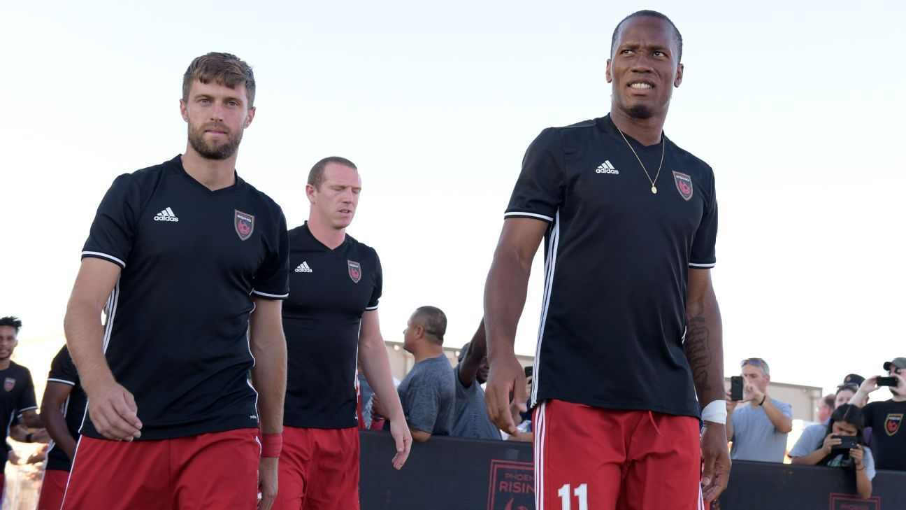 Blair Gavin and Didier Drogba of Phoenix Rising