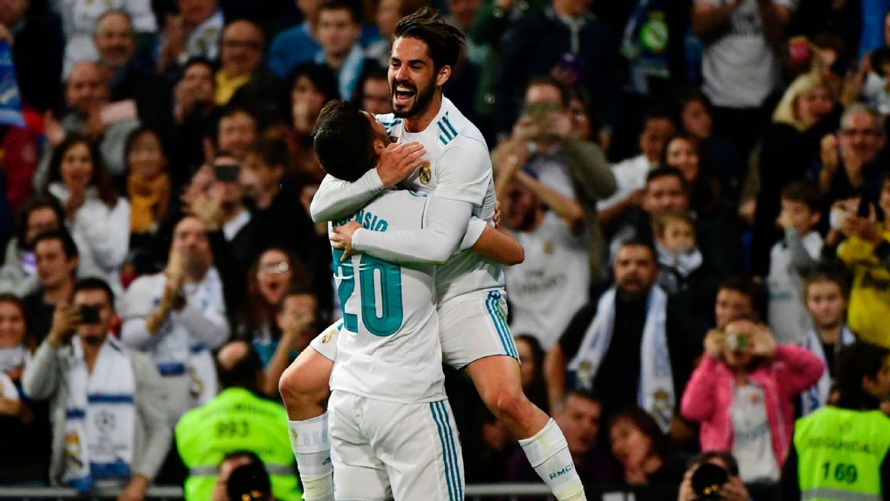 Isco and Marco Asensio celebrate Real Madrid's second goal on Sunday.