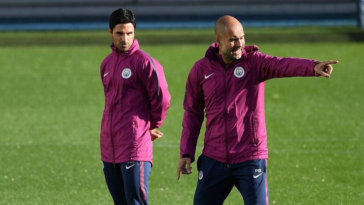 Mikel Arteta and Pep Guardiola during a Manchester City training session.