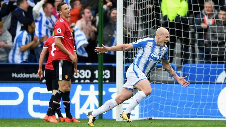 Huddersfield's Aaron Mooy celebrates scoring opening goal in win over Manchester United