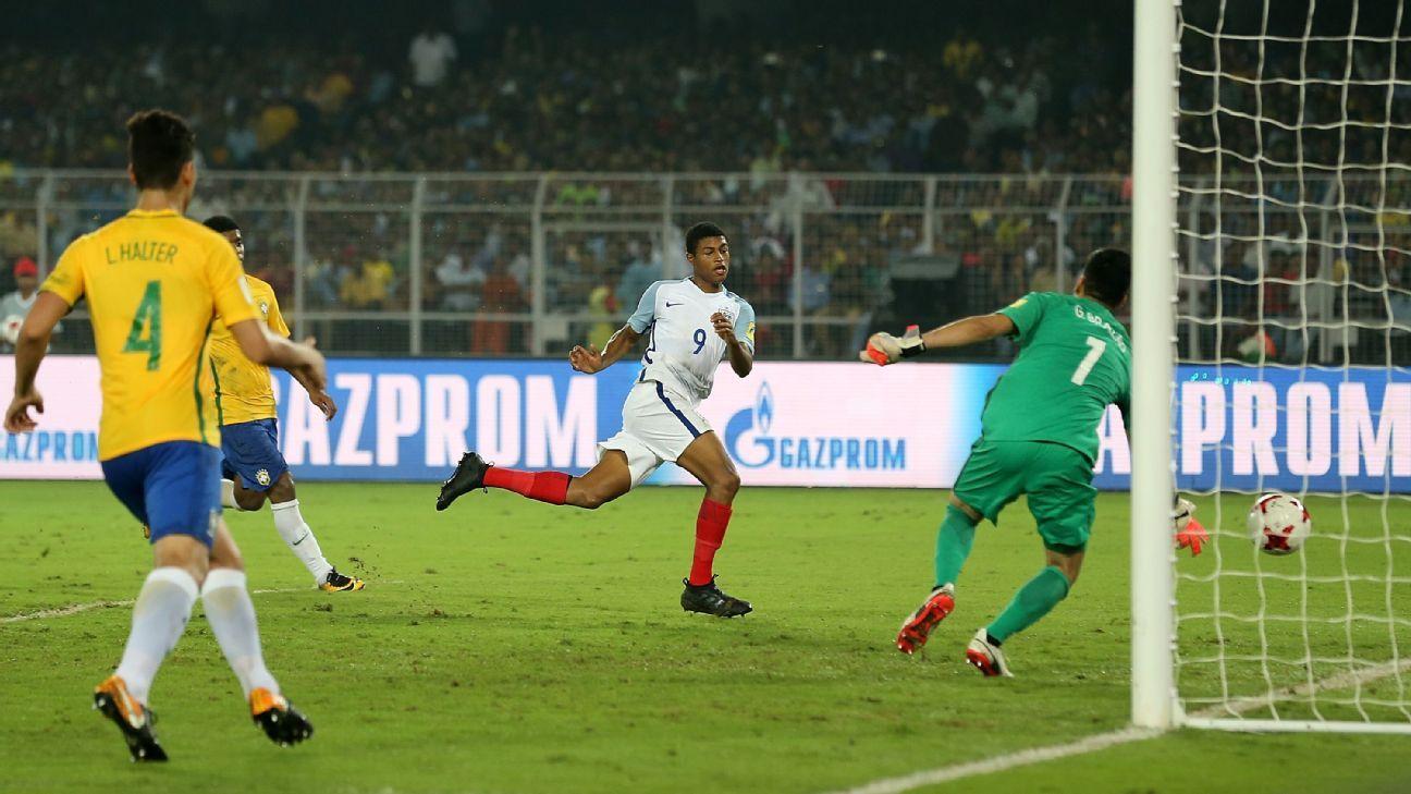 Rhian Brewster scores his hat-trick goal against Brazil.