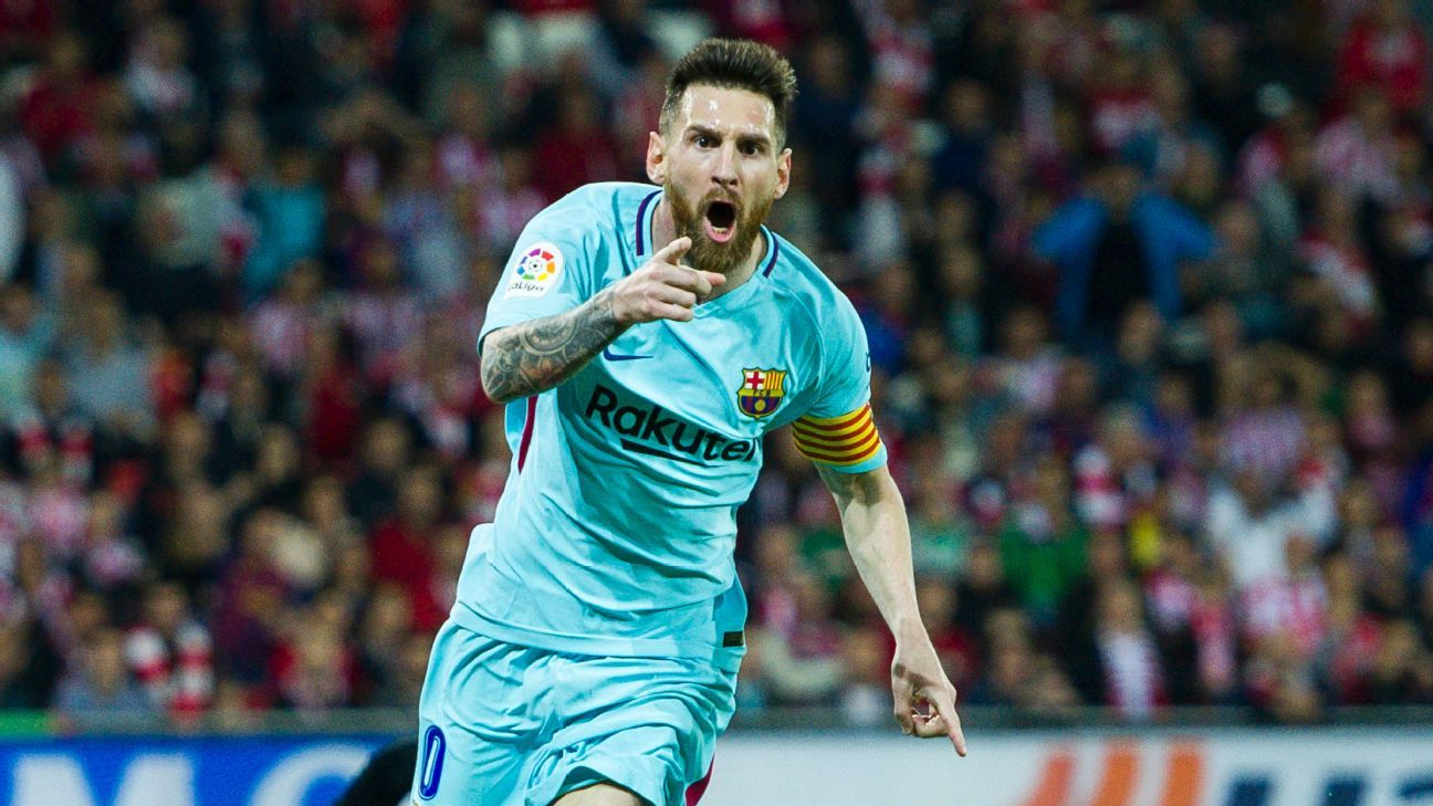 Lionel Messi celebrates after opening the scoring for Barcelona against Athletic Bilbao.