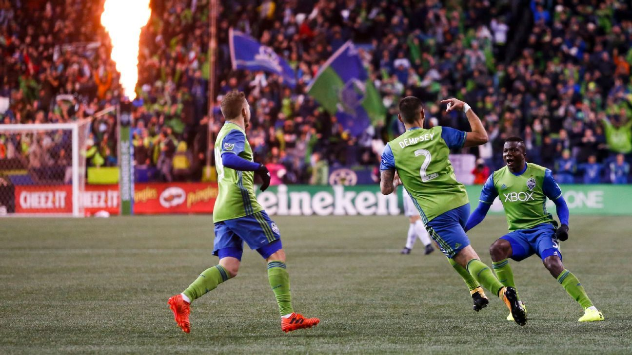 Clint Dempsey celebrates after putting Seattle in front against Vancouver in the MLS playoffs.