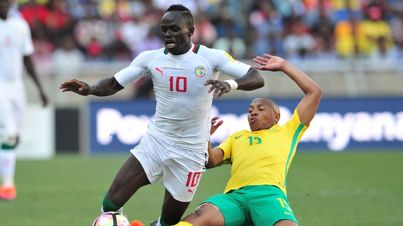 Sadio Mane of Senegal tackled by Andile Jali of South Africa during 2018 World Cup Qualifiers match.
