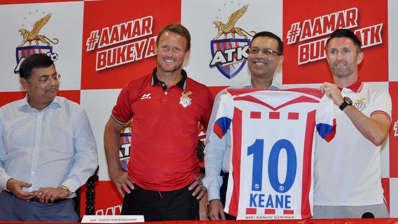 ATK's head coach Teddy Sheringham with new signing Robbie Keane