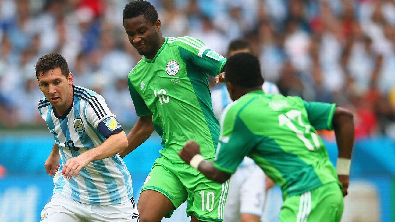 Lionel Messi of Argentina controls the ball against John Obi Mikel of Nigeria