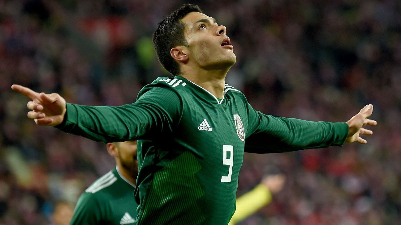 Raul Jimenez celebrates his goal in Mexico's defeat of Poland.