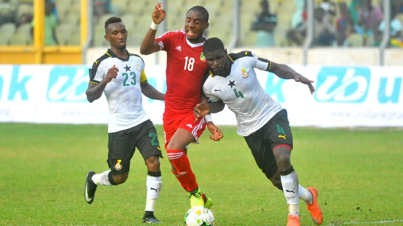 Bahamboula Dylan of Congo challenging Jonathan Mensah and Harrison Afful of Ghana during the World Cup qualifier between the two nations in Kumasi