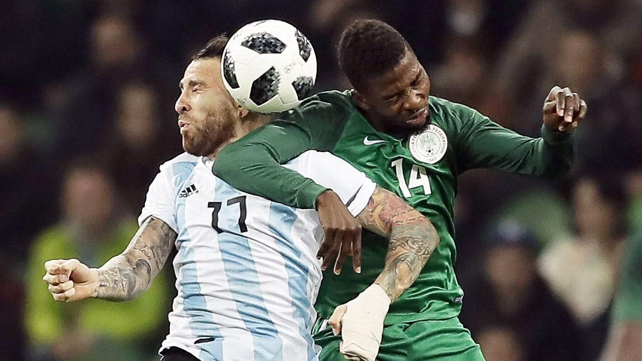 Nigeria's Kelechi Iheanacho & Nicolas Otamendi of Argentina