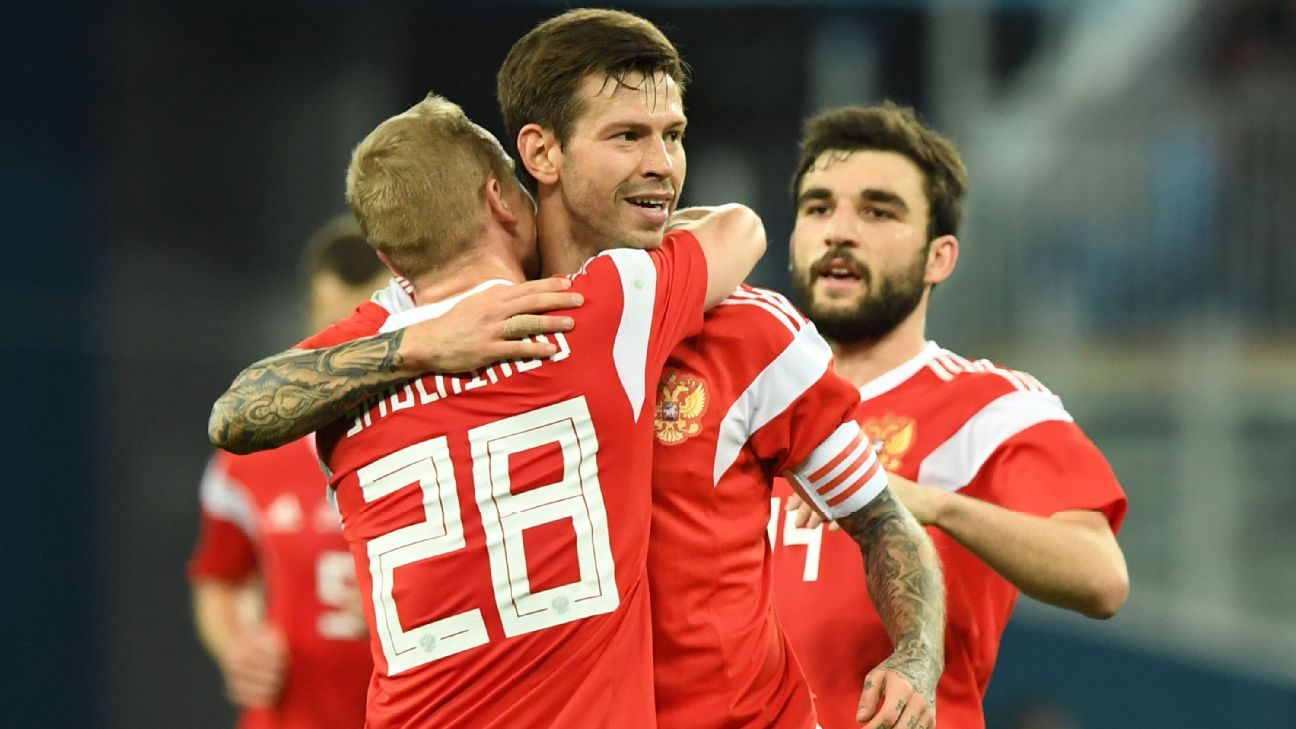 Fedor Smolov celebrates the first of his two goals in Russia's 3-3 draw with Spain.
