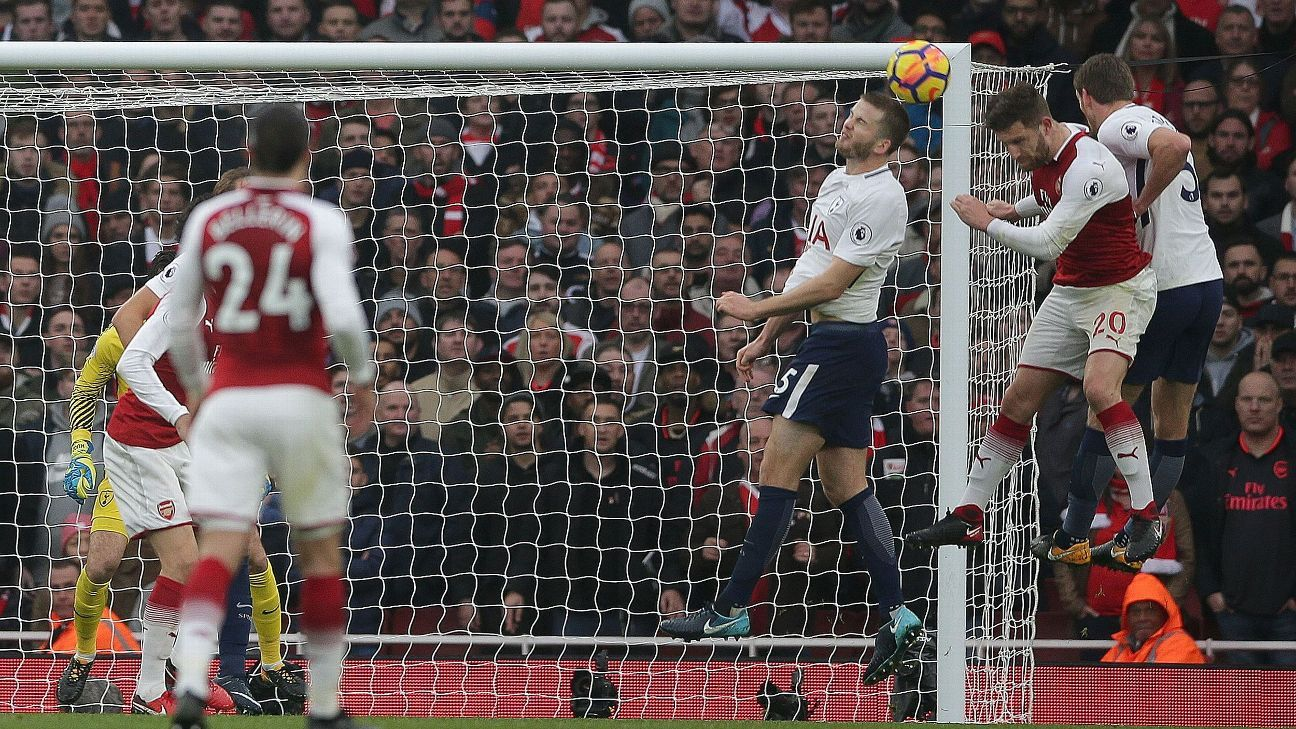 Shkodran Mustafi heads Arsenal in front at the Emirates.