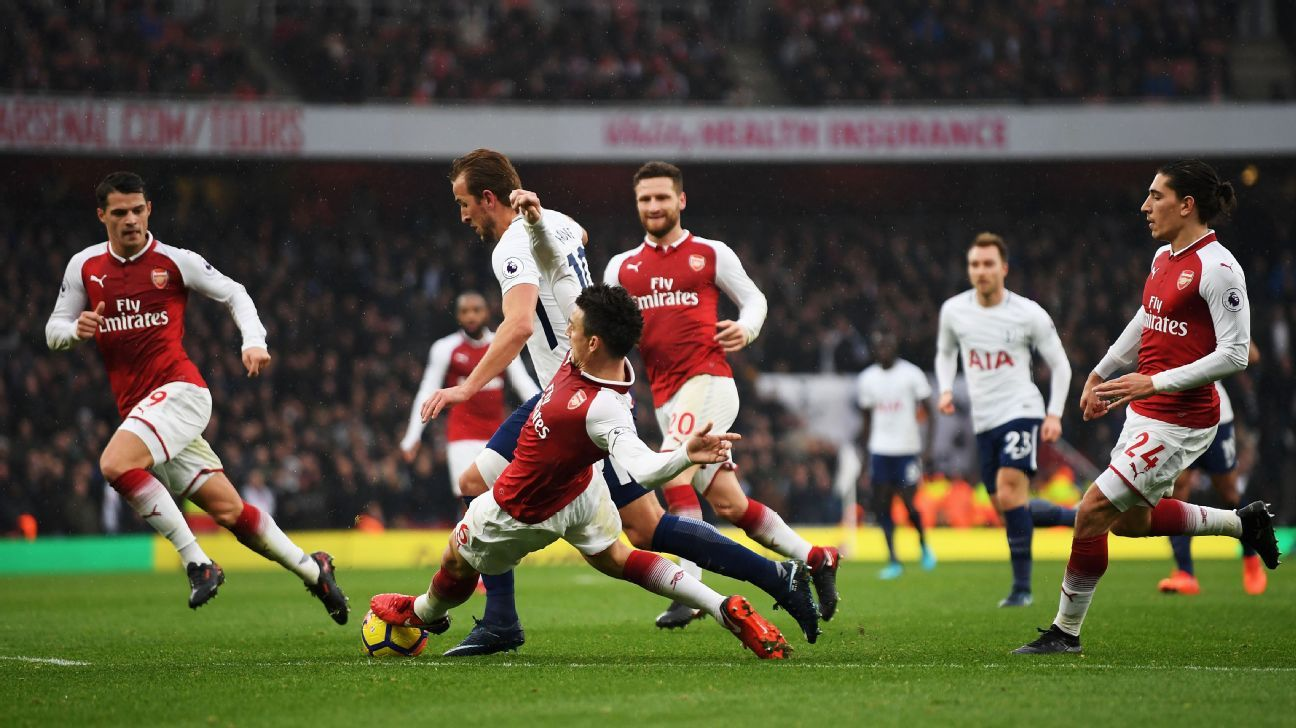 Laurent Koscielny denies Harry Kane in the North London derby.